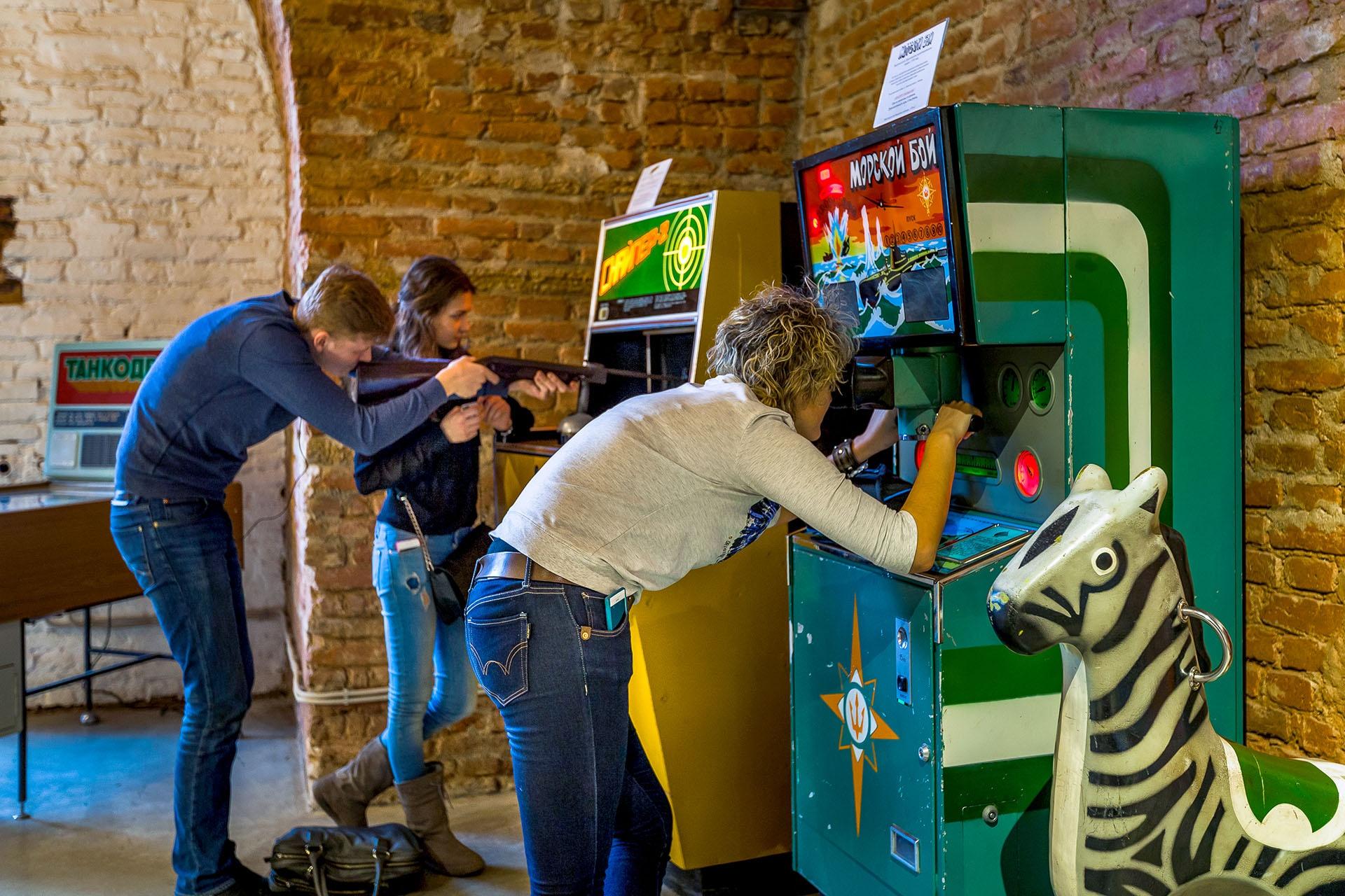 Having fun playing on the Soviet arcade machines!